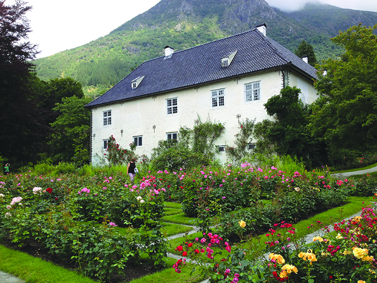Photo: Linn Chloe Hagstrøm Baroniet Rosendal, a 17th-century manor house complete with a medieval rose garden. The property, which is open to the public from May through September, features exhibitions, demonstrations, and other events.