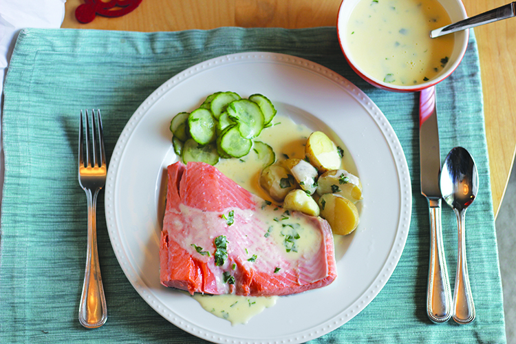 Photo: Christy Olsen Field Once you try this poached salmon with Sande­fjordsmør, you'll want to eat it all summer long.