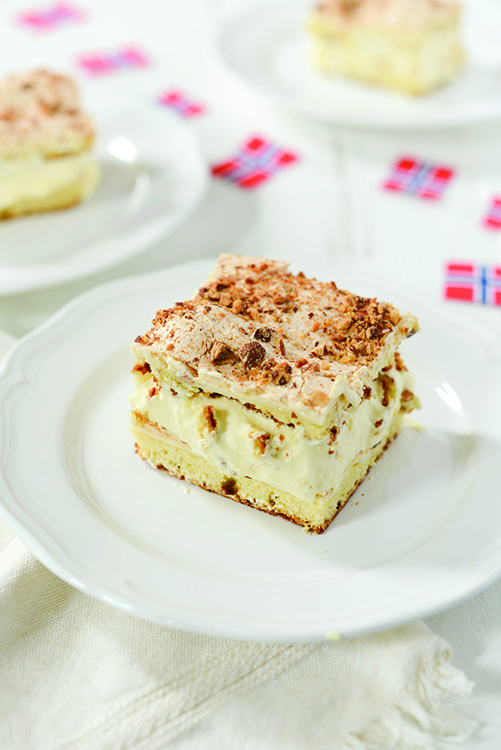 Photo: Daytona Strong Layers of cake, cream, meringue, and almonds make Kvæfjordkake a sure hit for Syttende Mai.