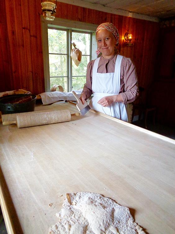 Photo: Cynthia Elyce Rubin A living history demonstrator at Skansen prepares flatbread.