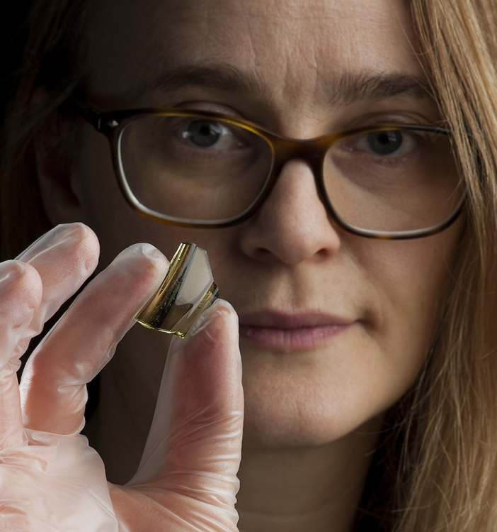 Photo: Åge Hojem, NTNU University Museum Ingrid Ystgaard holds a shard of a glass beaker imported from the Rhine area.