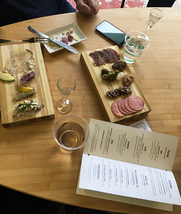 "Photo: Emily C. Skaftun The day's herring board (left, half-devoured) and ""land"" board (right) offer a sampling of Nordic fish and meat."