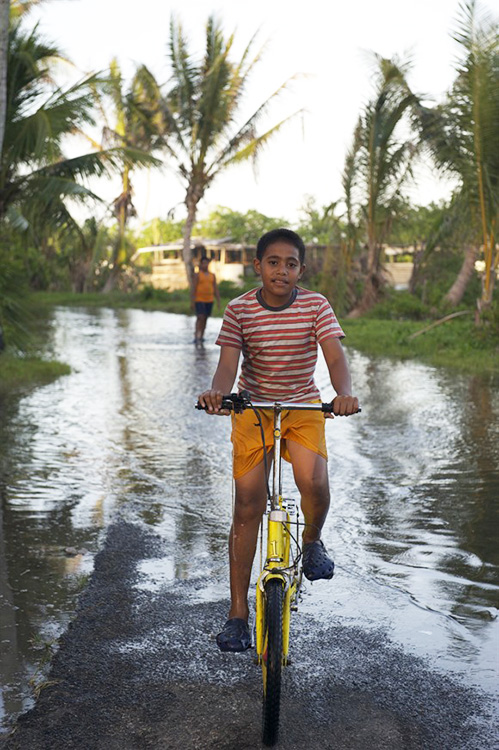 Photo courtesy of Many Strong Voices:  Maureen Pesega  Tuvalu couldn't be more different from Nesseby, Norway, but both are affected by climate change. In Tuvalu, rising sea levels are killing crops and causing disruptive floods.