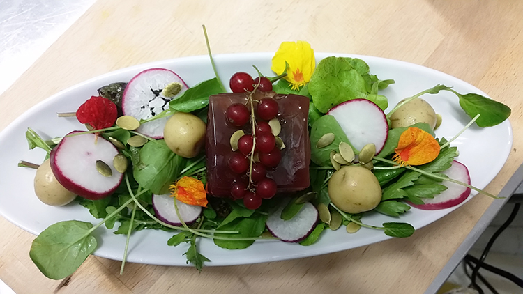Photo courtesy of Old Ballard A smoked vegetable terrine with leeks, beets, rainbow chard, and a wild mushroom aspic.