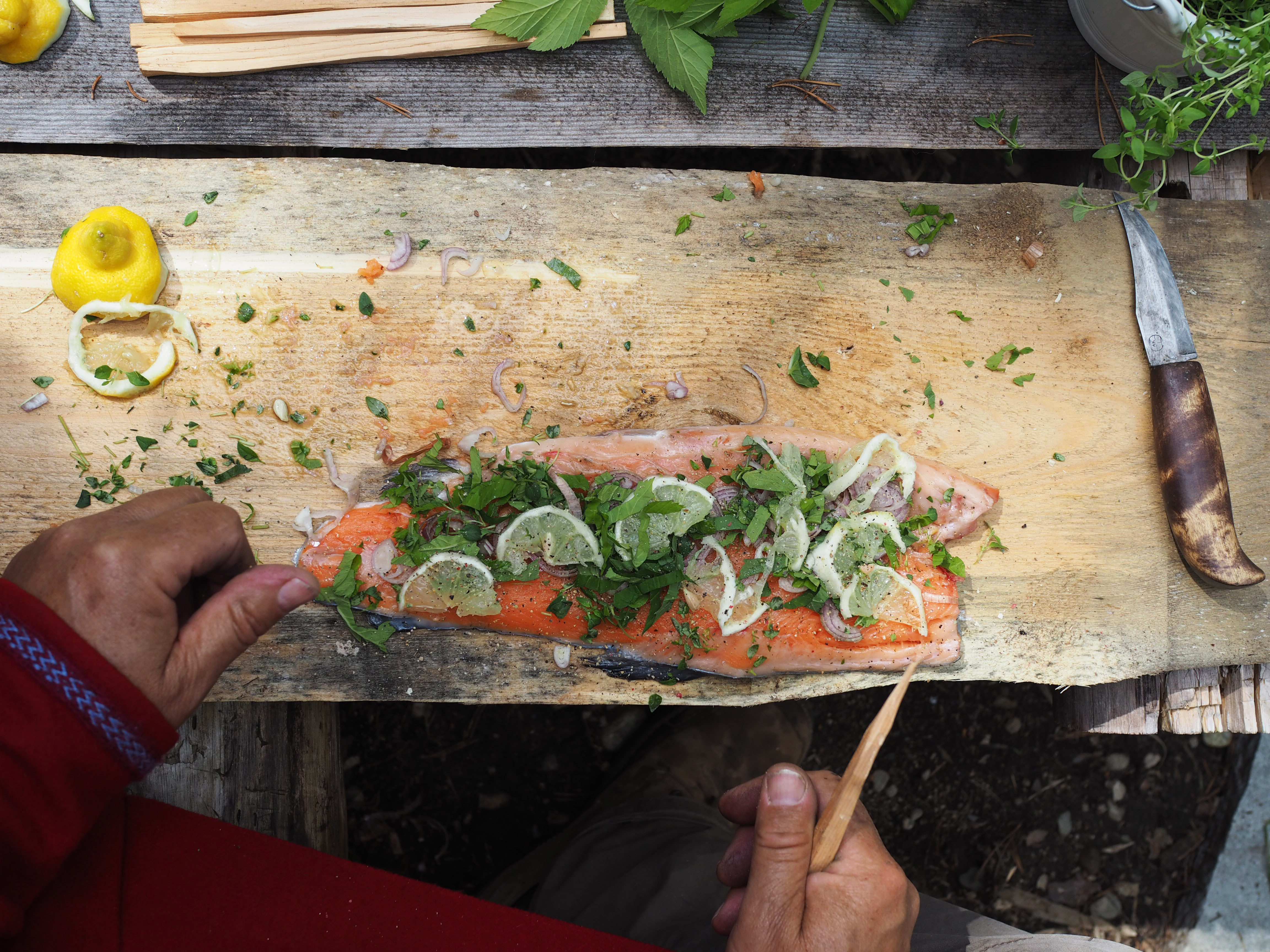 Photo: Nevada Berg  Preparing the plankefisk with shallots, herbs, and lemon.