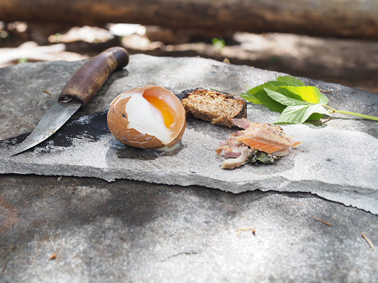 Photo: Nevada Berg Here all the elements of this Medieval feast are shown—bread, trout, an egg cooked over the campfire, and nature, the perfect element in which to eat.