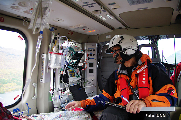 Photo: Tromsø University Hospital A doctor monitors a patient onboard a helicopter.