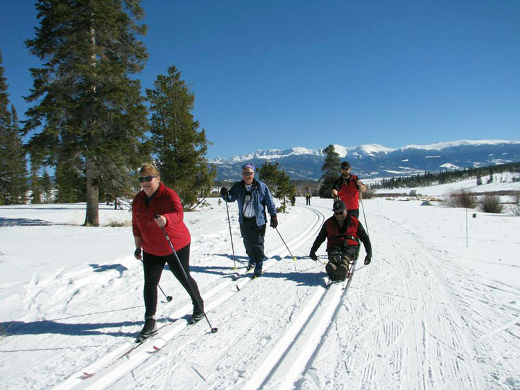 Photo: Leslee Lane Hoyum For 42 years Ski for Light has partnered sighted, non-disabled cross-country ski guides with visually- and mobility-impaired skiers, whether novice or experienced. Ski for Light trains guides and pairs skiers with guides based on a variety of factors, including ability, age, conditioning, and experience.