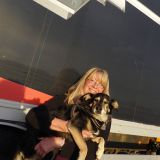 Photo: David Burke Lauren Hauser is living her third life in Norway. Shown here with her dog Depill.