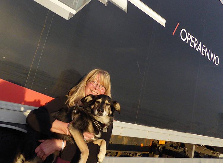 Photo: David Burke Lauren Hauser is living her third life in Norway. Shown here with her dog Depill.