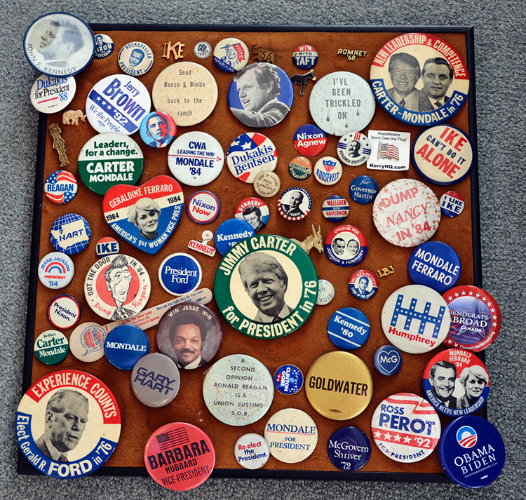 "Photo: Scott Larsen Scott's presidential button collection, started when he was a teenager. The oldest one is a 1916 Woodrow Wilson button (not shown) that reads: ""War in Europe, Peace in America, God bless Wilson."""