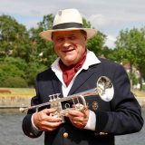 Kai Robert holding his trumpet.