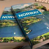 Two copies of Moon Norway guidebook.