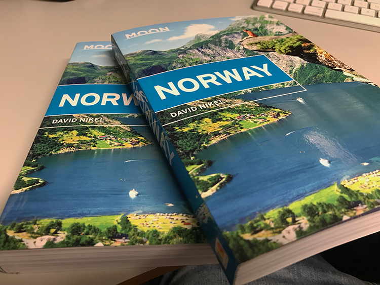 Two copies of Moon Norway guidebook.