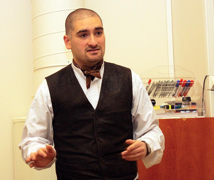 Dr. Adam Grydehøj speaking at a conference.
