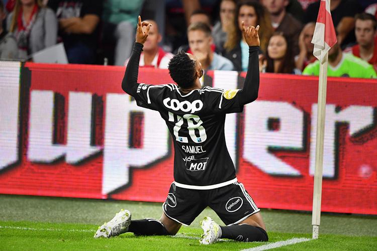 Soccer player Samuel Adegbenro celebrates after scoring a goal.