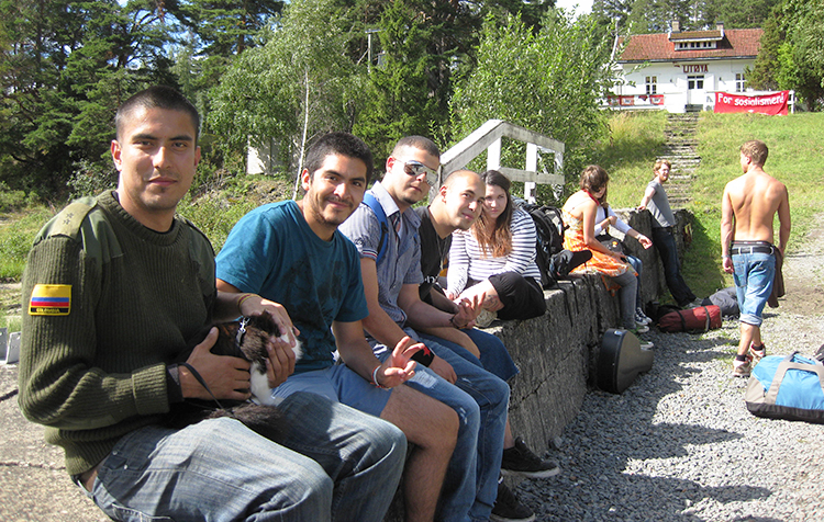 A group of young adults sitting together.