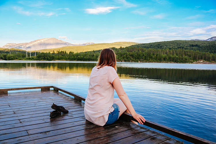 Vanessa sitting on the edge of the dock.