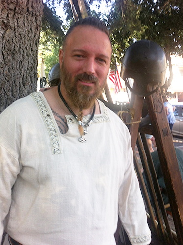 Man with Thor's hammer pendant.