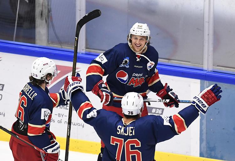 Mats Zuccarello, Brady Skjei, and Carl Hagelin on the ice.
