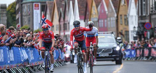 Norwegian cyclists ride past Bryggen.